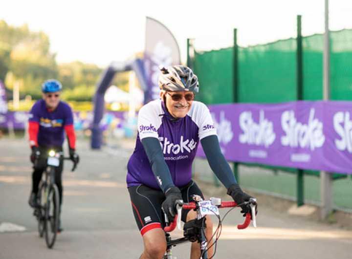 Sporting event bike rider wearing Stroke Association jersey