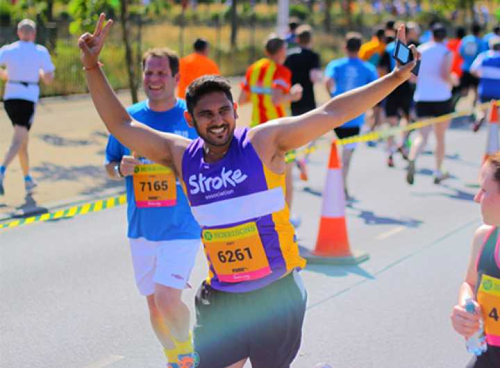 Runner doing two peace signs with hands