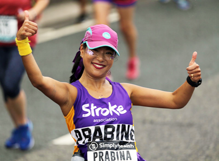 Event runner giving two thumbs up