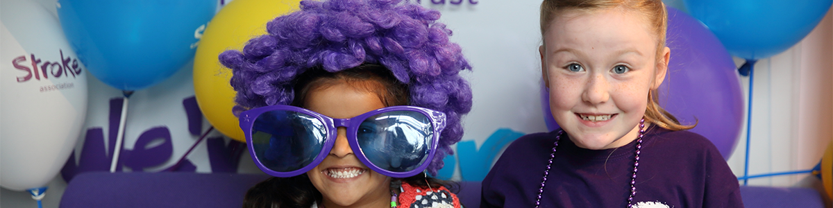 Two children with Stroke Association purple props